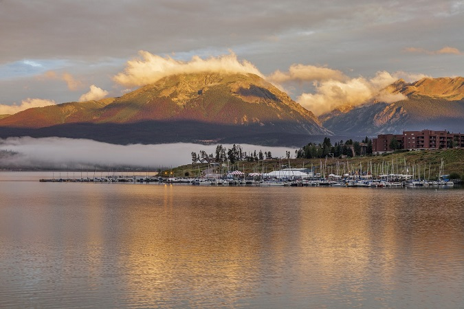 foggy sunrise over Lake Dillon and marina