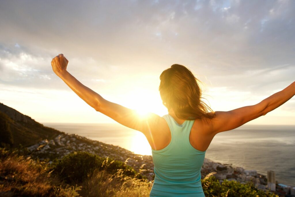 woman excited about summer in the mountains